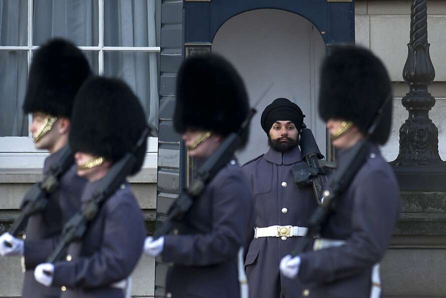 A little less on top: Sikh Scots Guards soldier Jatenderpal Singh Bhullar stands guard outsid
