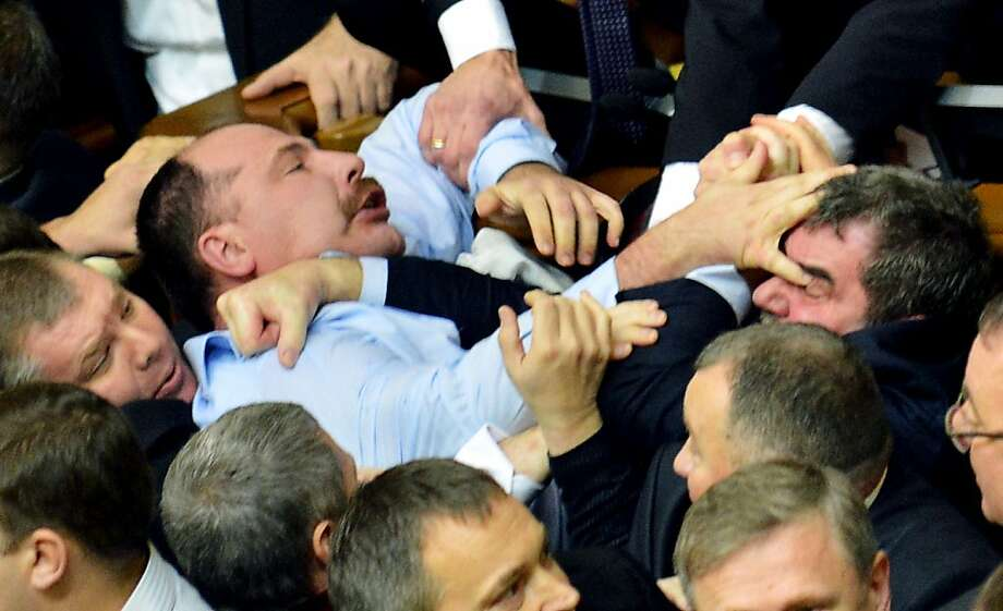 We agree then to disagree? Ukrainian lawmakers try to settle their differences on the floor of parliament in Kiev. Photo: Sergei Supinsky, AFP/Getty Images