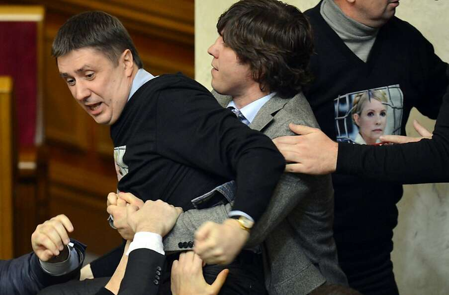 Parliamentary push comes to shove: Deputies of the Ukrainian opposition wear sweaters that sp