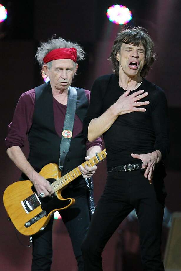 Keith Richards (left) and Mick Jagger of the Rolling Stones perform at 12-12-12: the Concert for Sandy Relief at New York's Madison Square Garden on Wednesday. Proceeds from the show will be distributed through the Robin Hood Foundation. Photo: Dave Allocca, Associated Press