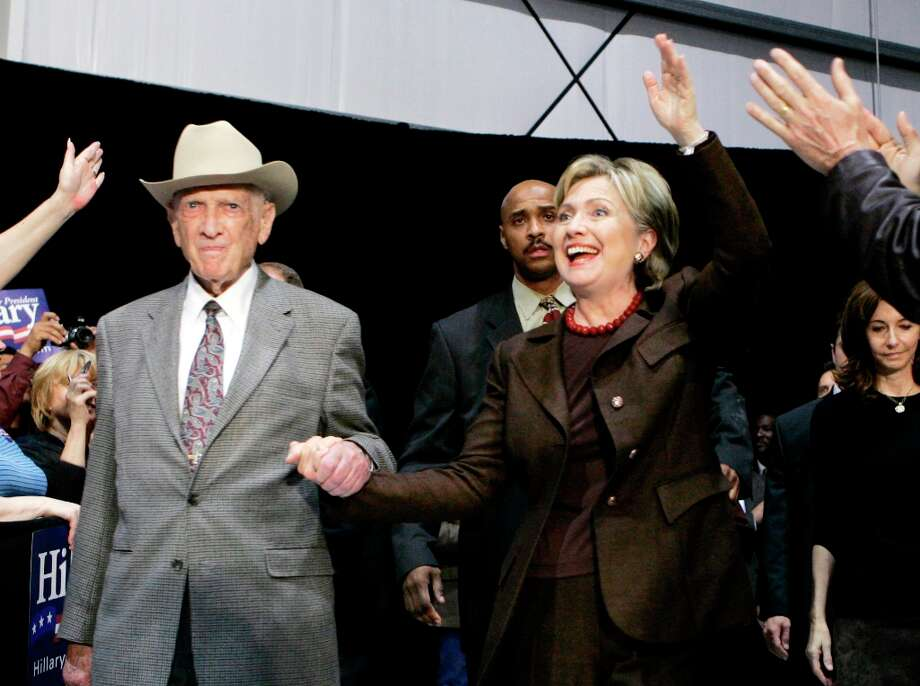 In this March 3, 2008, file photo, former U.S. Rep Jack Brooks escorts Hillary Rodham Clinton to the stage during a campaign stop at the Beaumont, Texas, Airport. Brooks, a Democrat who spent 42 years representing his Southeast Texas district, has died at age 89.  (Carolyn Kaster / AP Photo) Photo: Carolyn Kaster, Associated Press / AP