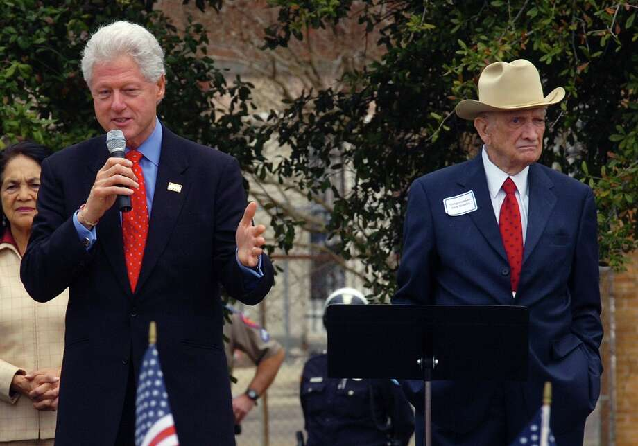 In this Feb. 20, 2008, file photo, former U.S. Rep. Jack Brooks, right, stands alongside former President Bill Clinton during a rally in downtown Beaumont, Texas. Brooks, a Democrat who spent 42 years representing his Southeast Texas district, has died at age 89.  (Guiseppe Barranco / AP Photo) Photo: Guiseppe Barranco, Associated Press / The Beaumont Enterprise