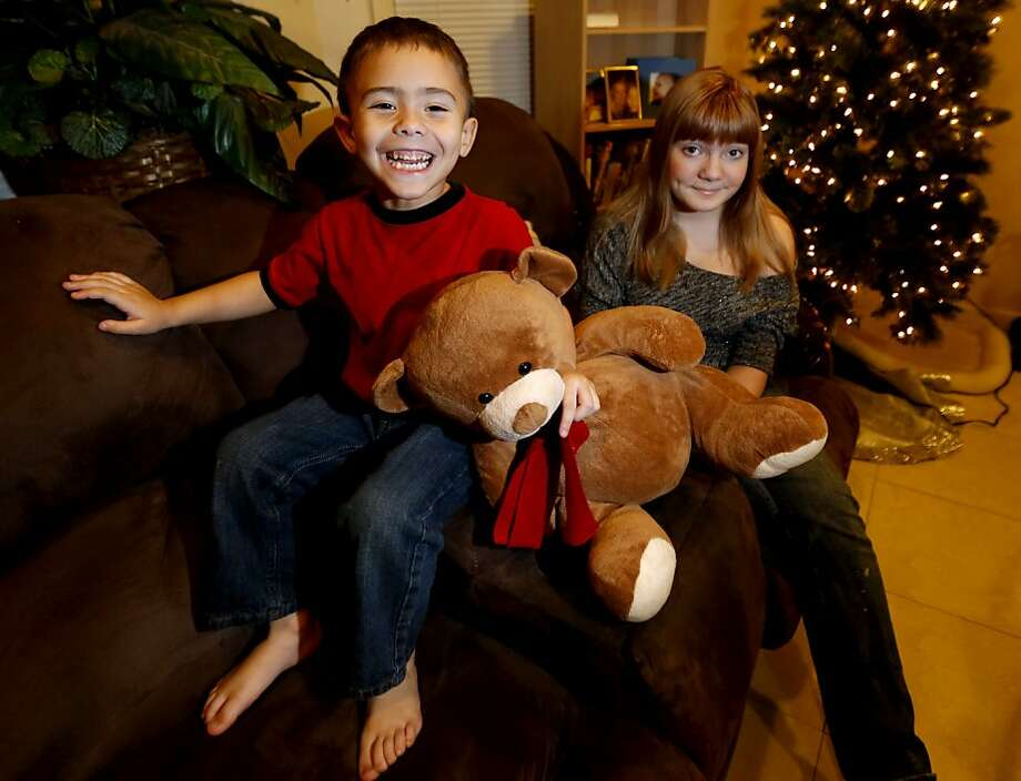 McKenna Pope (right), 13, and her brother Gavyn Boscio, 4, have gotten the attention of Hasbro. Photo: Julio Cortez, Associated Press