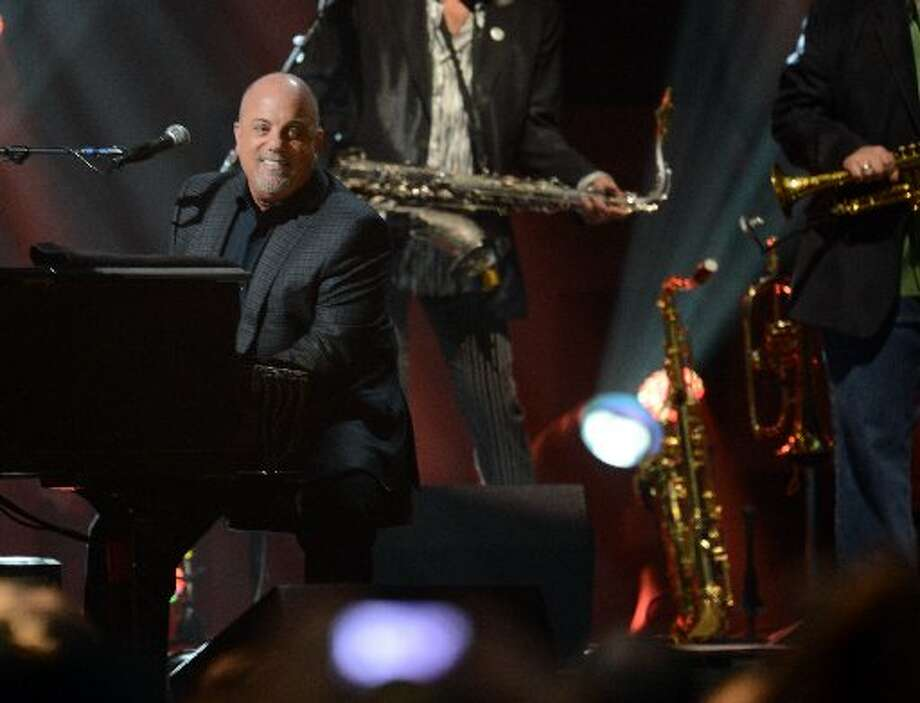 Billy Joel performs during 12-12-12 The Concert For Sandy Relief December 12, 2012 at Madison Square Garden in New York. AFP PHOTO/DON EMMERTDON EMMERT/AFP/Getty Images (Getty Images)