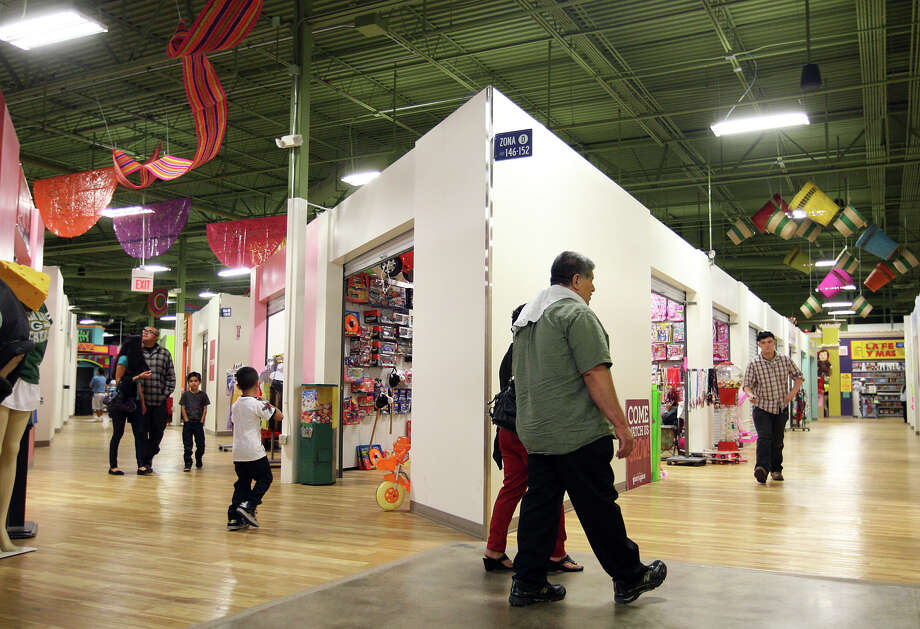 People shop at PicaPica Plaza, a mercado consisting of more than 200 small and family-owned businesses, Sunday, Dec. 9, 2012. The plaza is located in a building that used to house a Wal-Mart at 910 SE Military Drive. Photo: Jerry Lara, San Antonio Express-News / © 2012 San Antonio Express-News