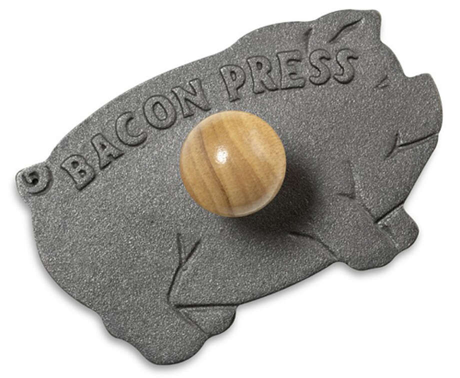 For the CarnivoreA cast-iron press in the shape of swine will have all the Guy Fieri-heads talking without, you know, giving money to Fieri.Pig bacon press ($11.99), amazon.com18 Of-the-Month Gifts for Dad's Stocking Photo: Contributed Photo