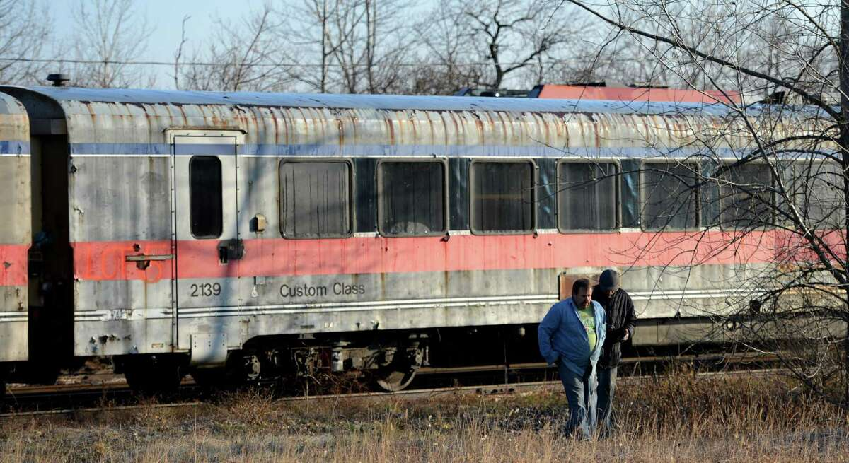 Interested parties look over one of the railroad cars that were auctioned off today at the Scotia Glenville Industrial Park in Scotia, N.Y. Dec 13, 2012. (Skip Dickstein/Times Union)