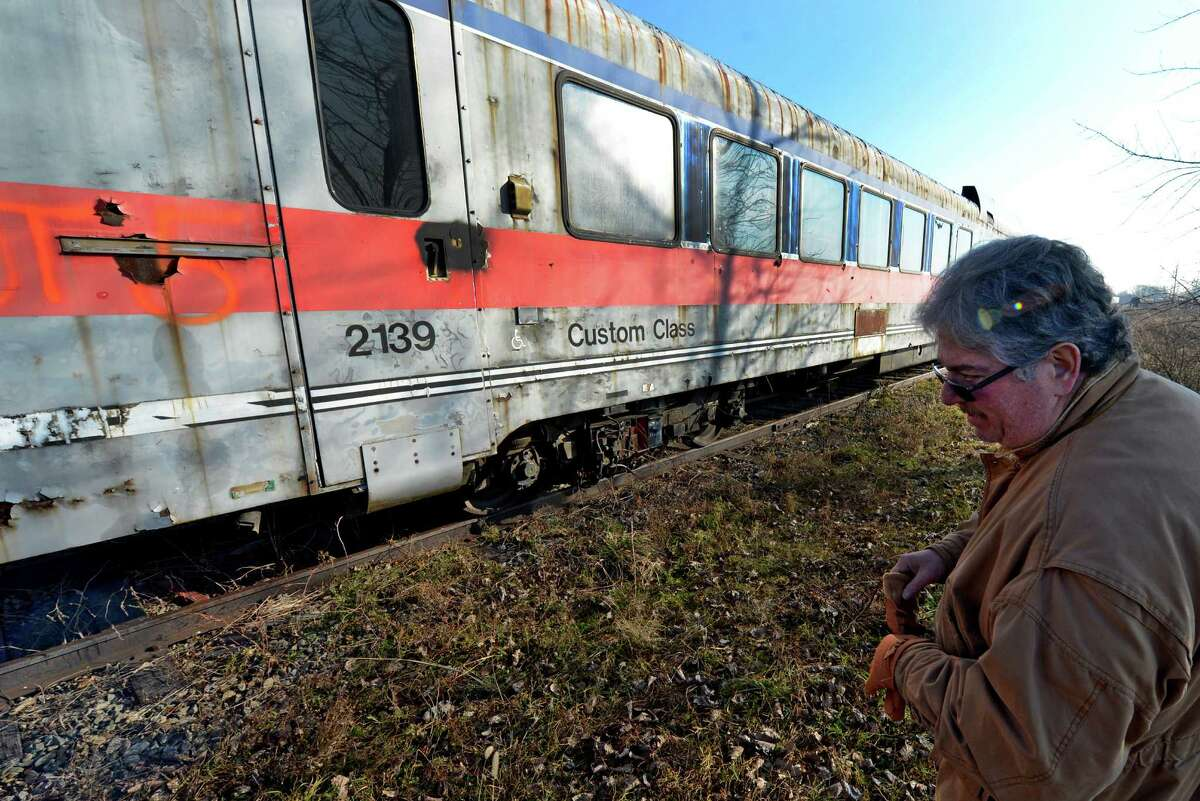 Kelman Scrap buyer Brian Pollack looks over railroad cars that were auctioned off today at the Scotia Glenville Industrial Park in Scotia, N.Y. Dec 13, 2012. (Skip Dickstein/Times Union)
