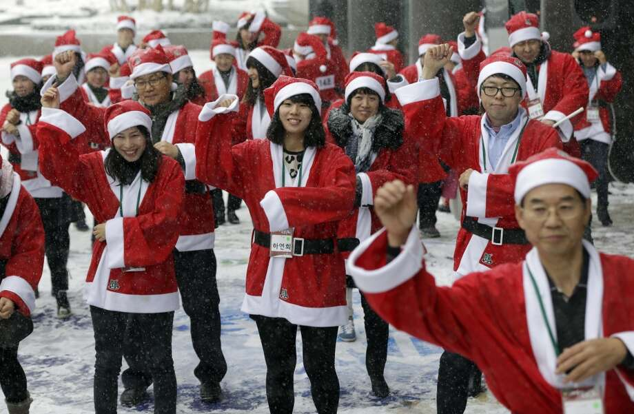 Volunteer workers, dressed in Santa Claus costumes, perform PSY's Gangnam Style dance during an event to visit and give Christmas gifts to prematurely born babies in Seoul, South Korea, Wednesday, Dec. 5, 2012.  (Associated Press)
