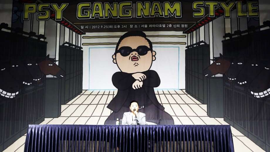 In this Sept. 25, 2012, file photo, South Korean rapper PSY, who sings the popular Gangnam Style song, answers reporters' question during a press conference in Seoul, South Korea.  (Associated Press)