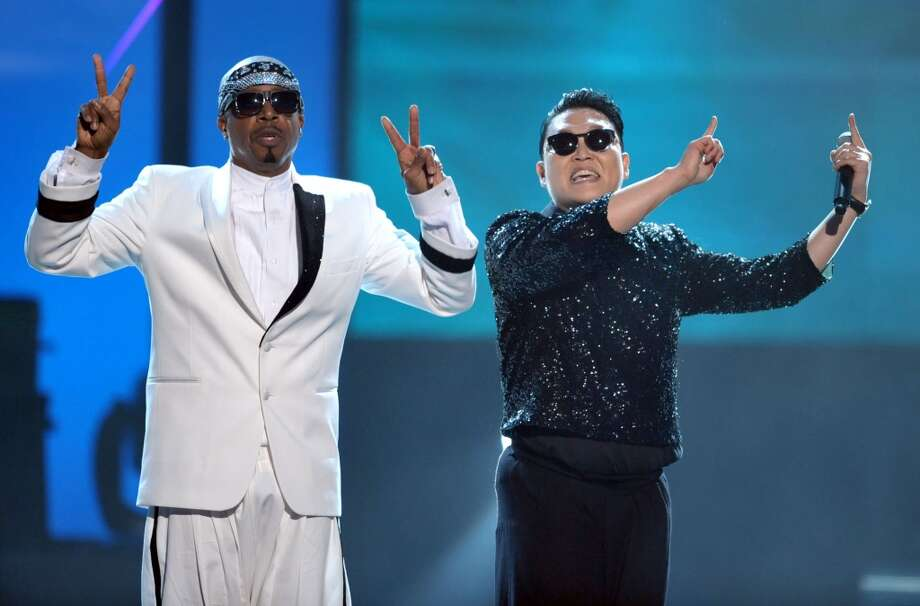 MC Hammer, left, and PSY are seen on stage at the 40th Anniversary American Music Awards on Sunday, Nov. 18, 2012, in Los Angeles. (Associated Press)