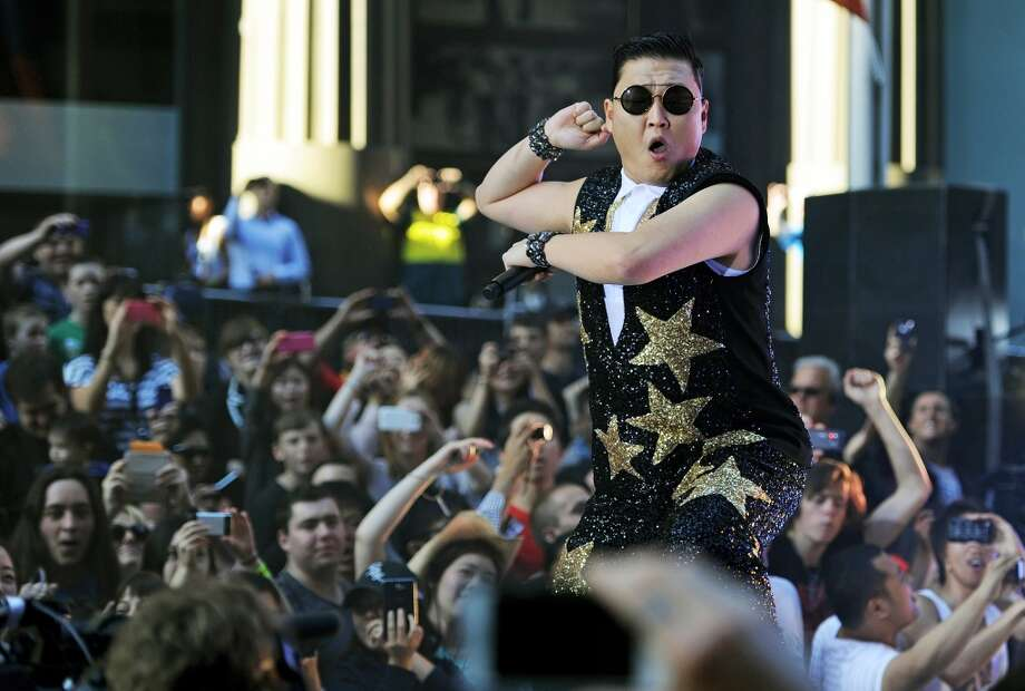 PSY performs for fans at a promotion by the Sunrise breakfast television show in central Sydney on October 17, 2012.  (AFP/Getty Images)