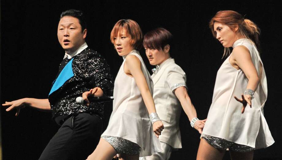 PSY performs during his public appearance in Singapore on December 1, 2012. (AFP/Getty Images)