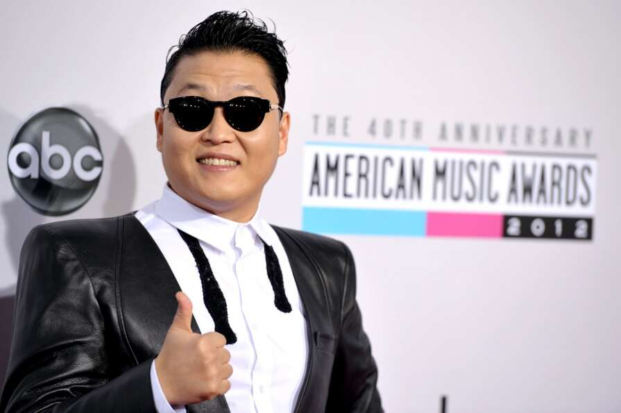 PSY arrives at the 40th Anniversary American Music Awards on Sunday, Nov. 18, 2012, in Los Angeles.