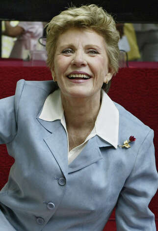 **FILE**Actress Patty Duke is honored with a star on the Hollywood Walk of Fame on  Aug. 17, 2004, in the Hollywood section of Los Angeles.The Oscar-winning actress will undergo single heart bypass surgery Wednesday, Nov. 3, 2004,  at Kootenai Medical Center in Coeur d'Alene, Idaho.(AP Photo/Damian Dovarganes) Photo: DAMIAN DOVARGANES / AP