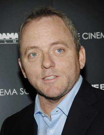 "** FILE ** Author Dennis Lehane attends the Cinema Society and Details Magazine hosted screening of ""Gone Baby Gone"" at the IFC Center in this Oct. 16, 2007 file photo in New York. (AP Photo/Evan Agostini, File) Photo: Evan Agostini / AGOEV"