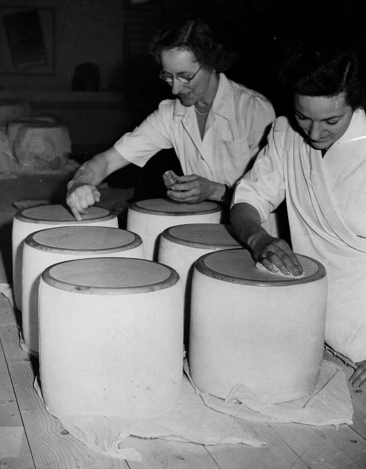 Workers prepare Cheshire cheeses on October 20, 1952 for the Dairy Show at Olympia, London. Photo: Ron Burton, Getty Images / Hulton Archive