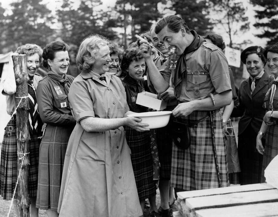 Chief Commissioner Designate for Scotland Lord Angus Ogilvy samples a cheese dish at the kitchen of the International Boy Scout Jamboree on July 25, 1960 at Blair Castle, Perthshire, Scotland. Photo: Central Press, Getty Images / Hulton Archive