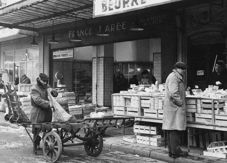 A cheese stall outside a shop in the vicinity of Les Halles, Paris is shown circa 1955. Photo: Three Lions, Getty Images / Hulton Archive