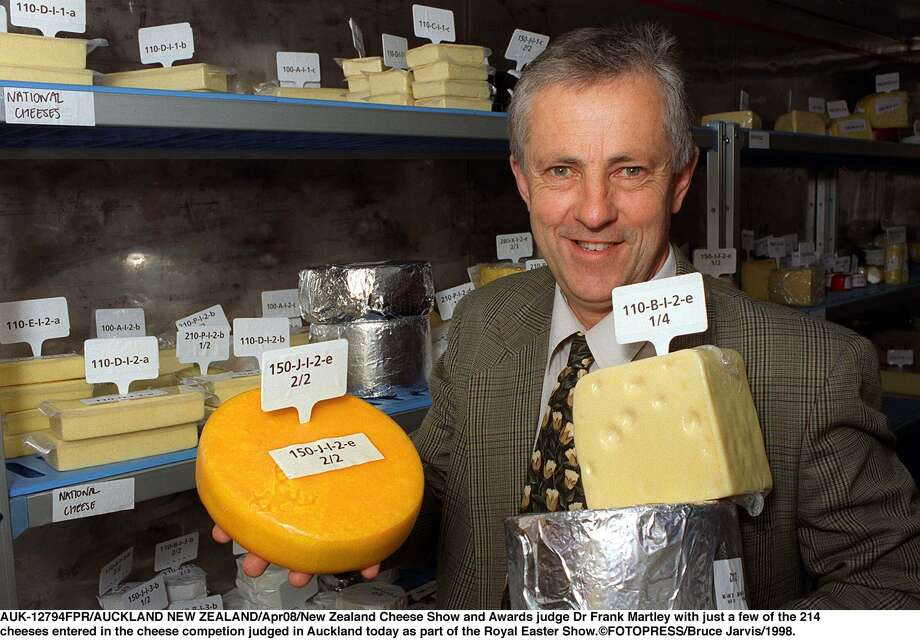 New Zealand Cheese Show and Awards judge Frank Martley poses with some of the 214 cheeses entered in the cheese competion on April 8, 1998, in Auckland, New Zealand. Photo: Bruce Jarvis, Getty Images / 1998 Getty Images