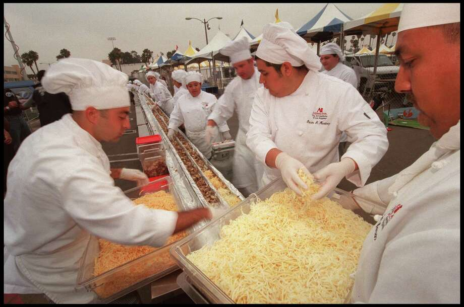 Chefs gather together to make the world's largest souffle on July 21, 2000 outside the Santa Monica Civic Auditorium in Santa Monica, Calif. The recipe called for 3,000 eggs, 60 pounds of butter, 100 pounds of cheese and 300 pounds of potatoes. Photo: Dan Callister, Getty Images / Getty Images North America