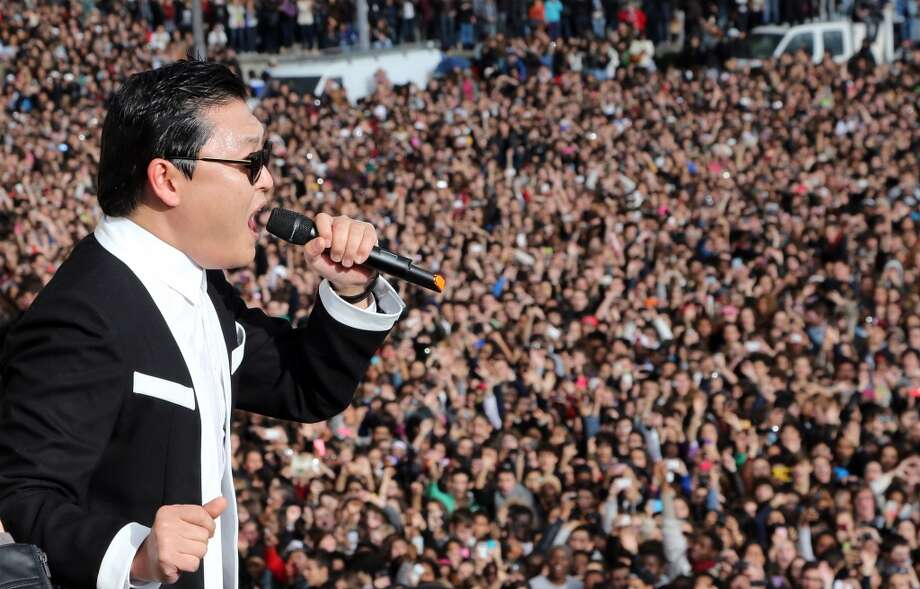 PSY performs Gangnam Style in front of a crowd during a flashmob on November 5, 2012 in Paris. (AFP/Getty Images)