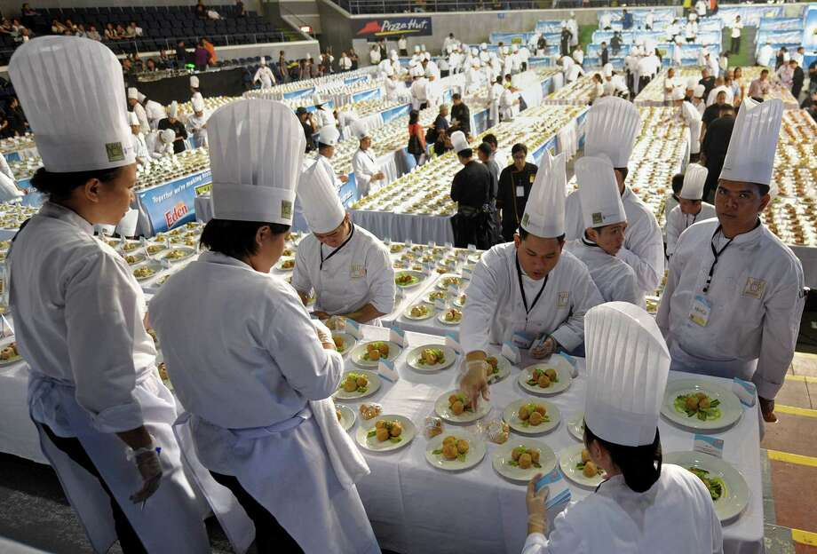 Philippine cooks from different culinary schools exhibit 5,000 dishes with ingredients of cheese in an attempt to set a new world's record at the Araneta coliseum in suburban Manila on December 14, 2009. Photo: JAY DIRECTO, AFP/Getty Images / 2009 AFP