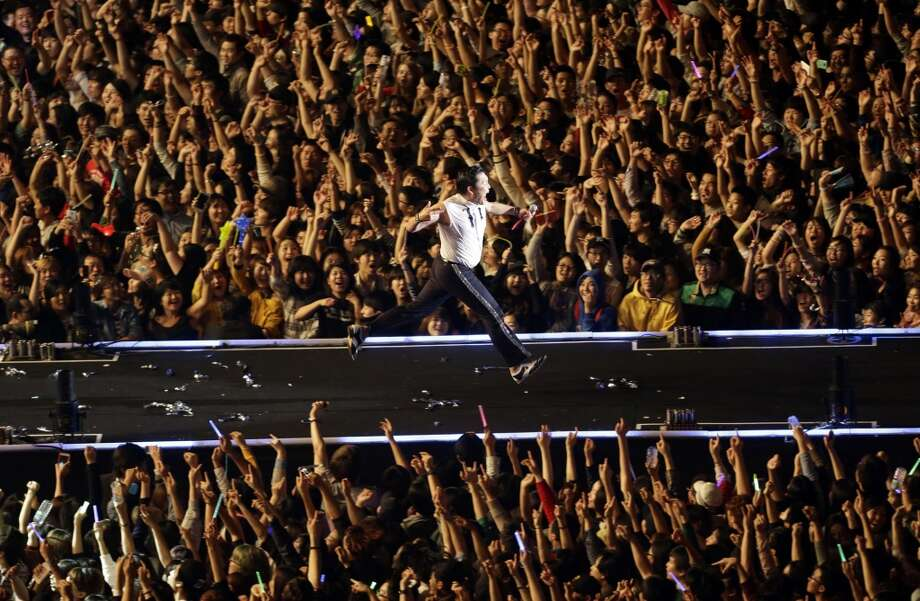 PSY performs during his concert, in Seoul, South Korea, Thursday, Oct. 4, 2012.   (Associated Press)