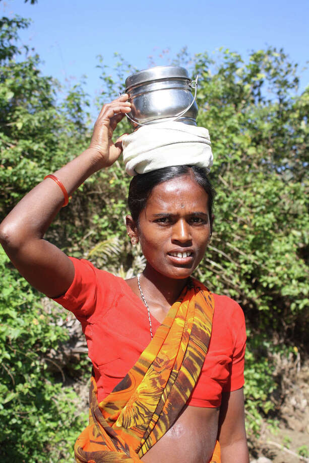 The Women's Earth Alliance helps women around the world --- such as this farmer in India --- secure their rights and safety by supporting them in addressing the environmental issues impacting their lives. Photo: IStockPhoto/Thinkstock