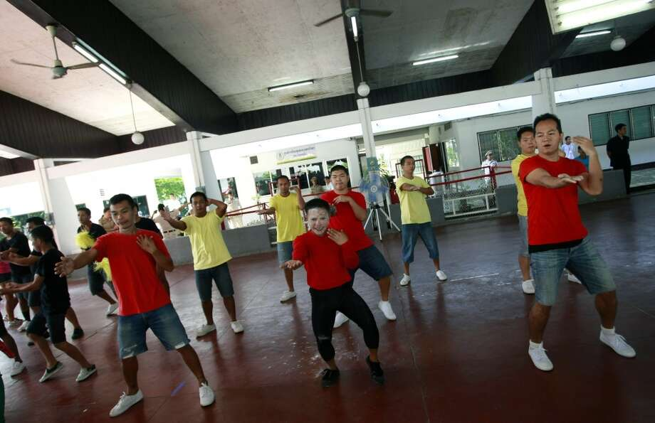 Thai inmates perform PSY's Gangnam Style dance during a dancing competition at a prison in Bangkok, Thailand Tuesday, Nov. 27, 2012. The event was held to encourage inmates to exercise more and coincided with the South Korean rapper's concert in Bangkok on Wednesday, Nov. 28, 2012. (Associated Press)