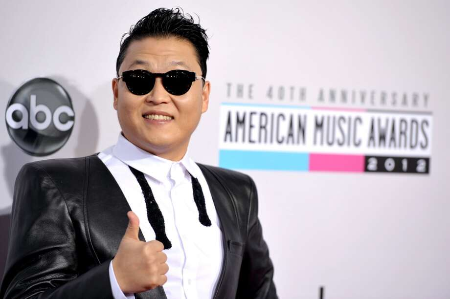 PSY arrives at the 40th Anniversary American Music Awards on Sunday, Nov. 18, 2012, in Los Angeles. (Associated Press)