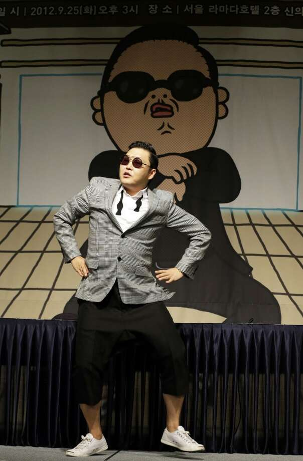 In this Sept. 25, 2012 photo, South Korean rapper PSY, who sings the popular Gangnam Style song, performs during a press conference in Seoul, South Korea.  (Associated Press)
