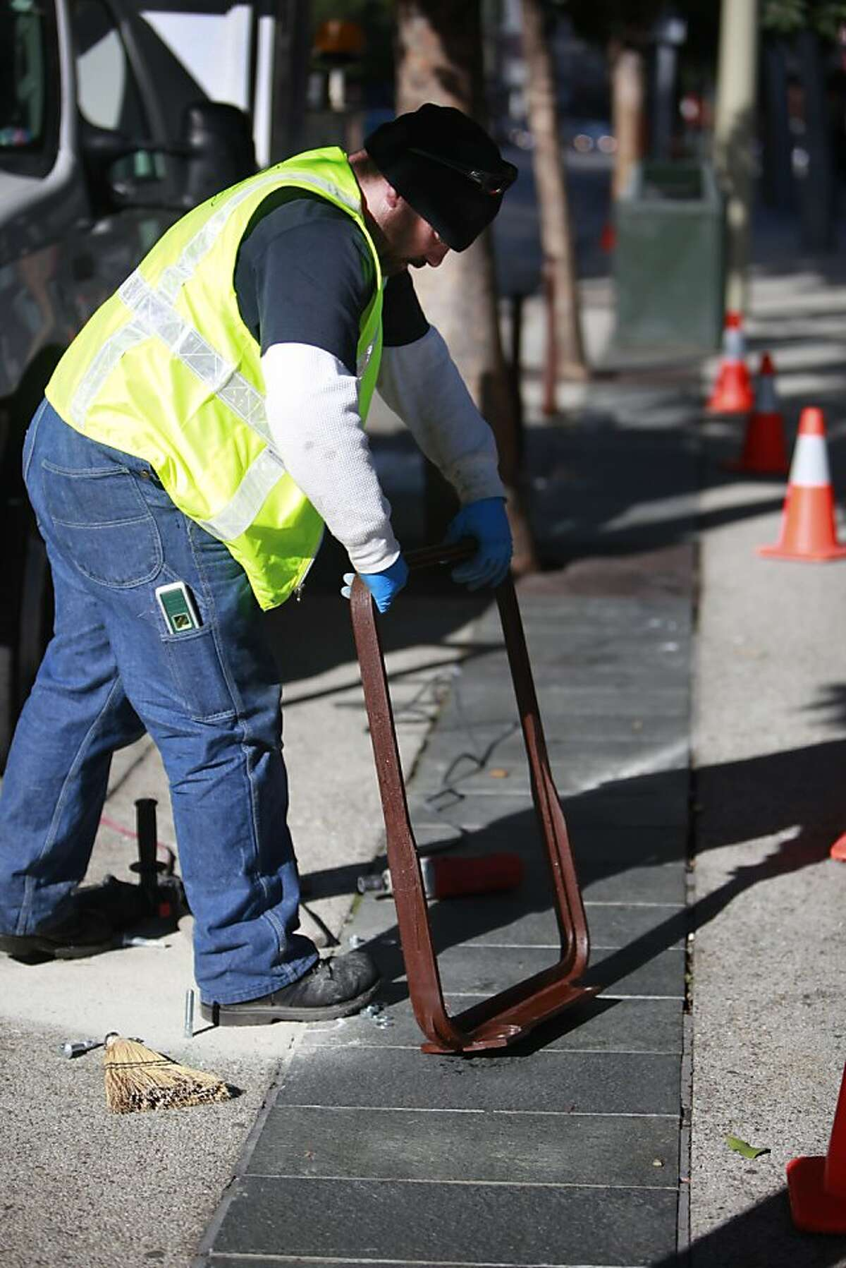 Mike Turner, sign installer SFMTA, installs new bike racks on 4th Street near Howard Street on Thursday, December 13, 2012 in San Francisco, Calif.