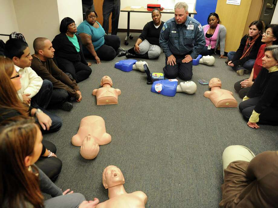 Paul Moeller teaches employees from Stamford-area non-profit organizations how to use automatic external defibrillators which were donated to the organizations by the United Way of Western Connecticut with a grant from the Herbert and Nell Singer Foundation on Thursday, December 13, 2012. Photo: Lindsay Niegelberg, Niegelberg / Stamford Advocate