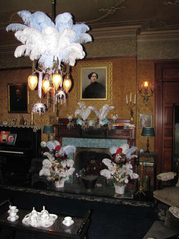 The Colonial Revival parlor at the Wilderstein mansion. The portrait above the mantle is Daisy Suckley's grandmother, Catharine Suckley. The portrait at left is her father, Robert Suckley.