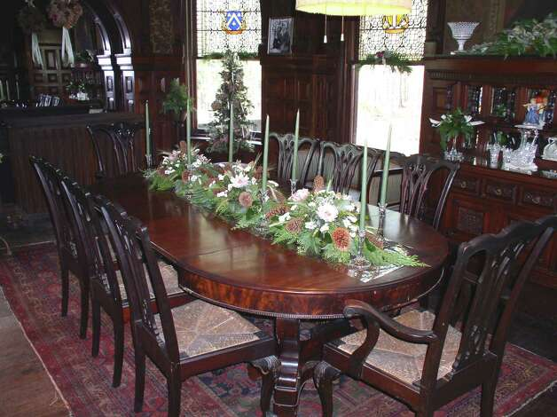 The dining room at Wilderstein. The house was decorated by Joseph Burr Tiffany, a cousin of Louis Comfort Tiffany. The two weren't getting along at the time the windows were made, so they are not thought to be Tiffany windows.