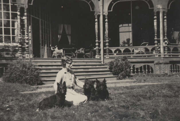 Daisy Suckley at Wilderstein in 1945 with Button, Mac and Peggy, who were offspring of Button and Fala, President Roosevelt's famous Scottie.