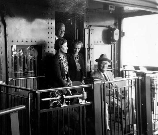 Daisy Suckley, left, on a train with President Roosevelt in 1943.