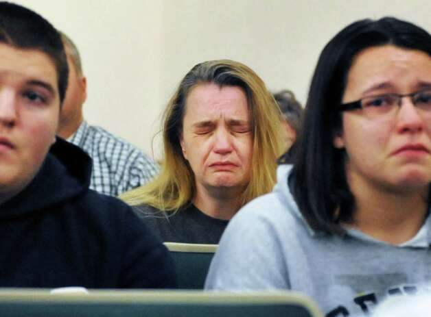Kim Ryan, center, reacts as Steven McComsey, who pleaded guilty last month to one count of negligent homicide for a house blast that killed six, is sentenced in Washington County Court Thursday Dec. 13, 2012. Ryan's sister Tammy Palmer died in the blast.   (John Carl D'Annibale / Times Union) Photo: John Carl D'Annibale / 00020427A