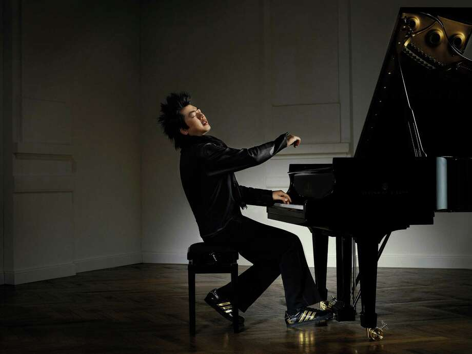 "New to the Quick Center this season, ""Orchestra in HD"" features the Berliner Philharmoniker, conducted by Sir Simon Rattle and featuring pianist Lang Lang (pictured) in an encore HD broadcast from the PhilharmonikerâÄôs home concert hall in Berlin at 3 p.m. Sunday, Dec. 16. Photo: Contributed Photo/Detlef Schneid"