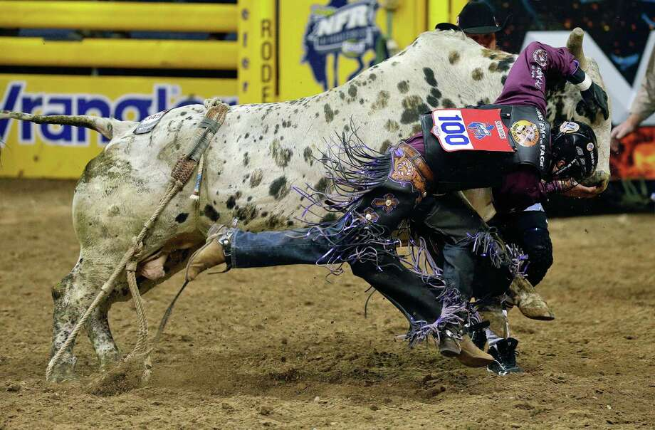 Beau Schroeder, of China, Texas is chased down by the bull Summer Nights after falling off during the bull riding competition of the National Finals Rodeo, Wednesday, Dec. 12, 2012, in Las Vegas. (AP Photo/Julie Jacobson) Photo: Julie Jacobson, STF / AP