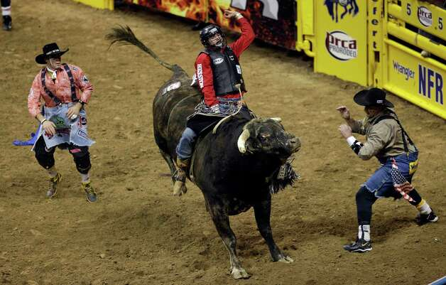 Cody Teel, of Kountze, Texas, stays atop Glory Days for a fifth-place finish in the bull riding competition of the National Finals Rodeo, Wednesday, Dec. 12, 2012, in Las Vegas. (AP Photo/Julie Jacobson) Photo: Julie Jacobson, STF / AP