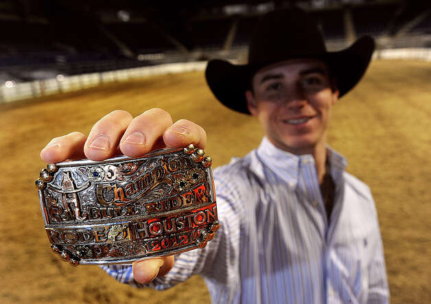 Local rider Beau Schroeder will perform at the YMBL Rodeo on Friday. Schroeder won the 2012 Houston Rodeo with a broken spine and said his goal is to ride the National Finals Rodeo in Vegas. Photo taken Monday, March 26, 2012 Guiseppe Barranco/The Enterprise Photo: Guiseppe Barranco, STAFF PHOTOGRAPHER / The Beaumont Enterprise