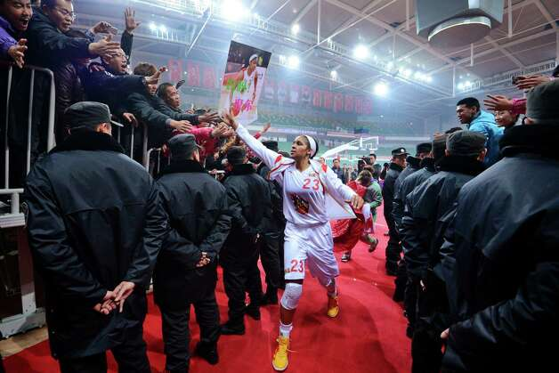 In this Nov. 24, 2012, photo, Shanxi Flame's Maya Moore greets fans as she prepares to take the court for a WCBA basketball game against the Jiangsu Dragons in Taiyuan, China. While her Minnesota Lynx team awaits the return of WNBA training camp in May, Moore is averaging 45 points a game and earning mid-six figures for the Flame, helping bring new fans to the women's game in a baseball crazed nation. (AP Photo/CHINATOPIX)  CHINA OUT Photo: Uncredited, Associated Press / CHINATOPIX
