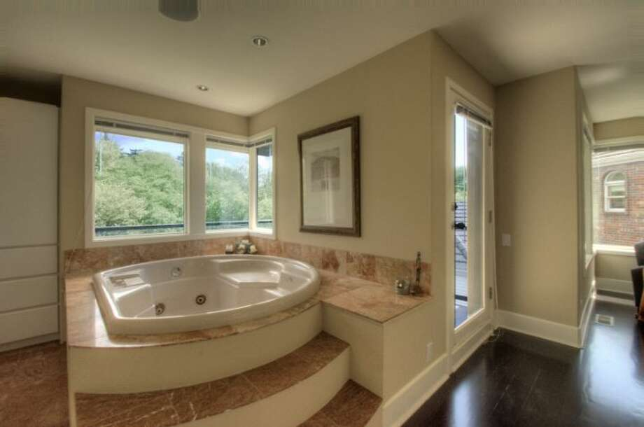 Master bathroom of 1529 Magnolia Boulevard W. The 4,500-square-foot house, built in 1991, has four bedrooms and 3.5 bathrooms, a two-story entry, curved walls, big windows and four decks on an 8,160-square-foot lot. It's listed for $995,000. Photo: Courtesy Pat Craft/Windermere Real Estate