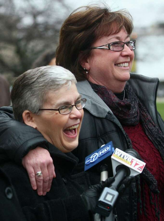 Kathy Chapman, left, a childhood friend of Maria Ridulph who was with  her in 1957 on the day she disappeared, and Mary Hunt, Jack  McCullough's half-sister, take questions from the media Monday, Dec. 10,  2012, outside the DeKalb County Courthouse in DeKalb, Ill., following  Jack McCullough's sentencing. McCullough, 73, was convicted of  kidnapping and murdering Ridulph more  than a half century ago and was  sentenced to life in prison.  (AP Photo/Daily Chronicle, Kyle Bursaw) Photo: AP