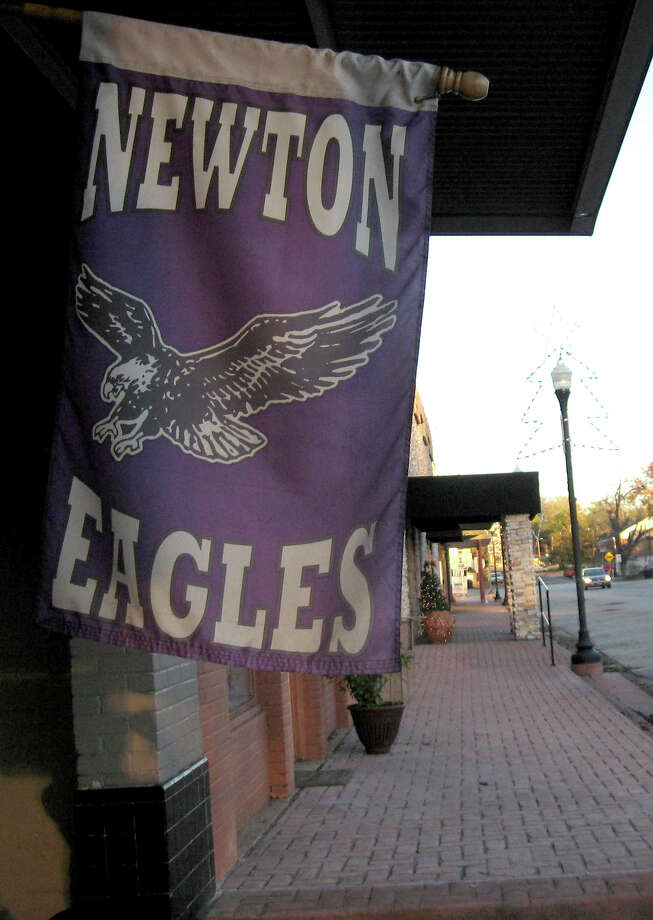 A Newton Eagles flag hangs outside of a restaurant on Court Street in downtown Newton. Newton will take on Cameron Yoe in the 2A-DI semifinals on Friday at Woodforest National Bank Stadium. David Berry/The Enterprise