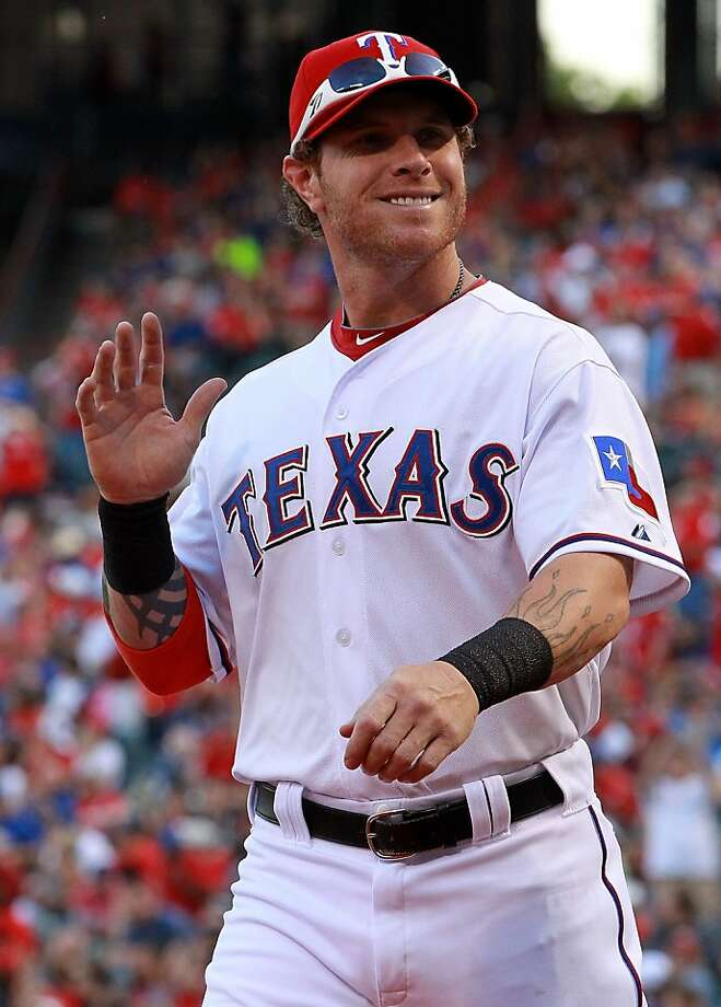 (FILE PHOTO) The Los Angeles Angels have reportedly agreed a five-year $125 million deal with the 2010 American League Most Valuable Player ARLINGTON, TX - APRIL 07:  Josh Hamilton #32 of the Texas Rangers at Rangers Ballpark in Arlington on April 7, 2012 in Arlington, Texas.  (Photo by Ronald Martinez/Getty Images) Photo: Ronald Martinez, Getty Images