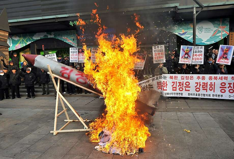 South Korean conservative activists set fire to a mock North Korean missile and an effigy (C, unseen) of North Korean leader Kim Jong-Un during a protest denouncing North Korea's rocket launch the day before, in Seoul on December 13, 2012. North Korea's rocket launch is a timely boost for its young leader, securing his year-old grip on power and laying to rest the humiliation of a much-hyped but failed launch eight months ago, analysts say. AFP PHOTO / JUNG YEON-JEJUNG YEON-JE/AFP/Getty Images Photo: Jung Yeon-je, AFP/Getty Images