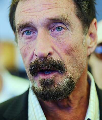 "MIAMI BEACH, FL - DECEMBER 13:  John McAfee talks to the media outside Beacon Hotel where he is staying after arriving last night from Guatemala on December 13, 2012 in Miami Beach, Florida. McAfee is a ""person of interest"" in the fatal shooting of his neighbor in Belize and turned up in Guatemala after a month on the run in Belize.  (Photo by Joe Raedle/Getty Images) Photo: Joe Raedle, Getty Images"